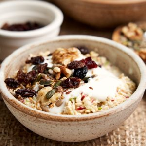 Bircher Muesli Recipe - Close up of bowl showing oats, yogurt and toppings | The Worktop