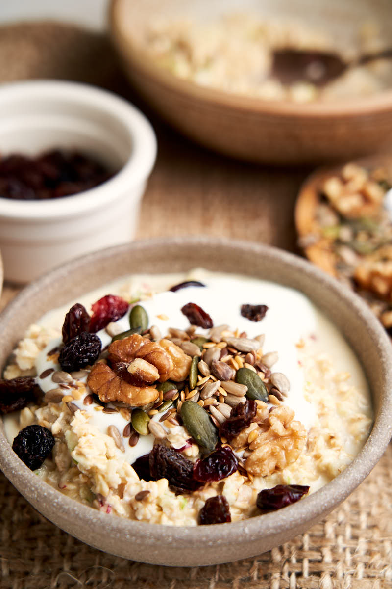 Creamy Bircher Muesli - Bowl of soaked oats with yogurt and toppings for breakfast | The Worktop