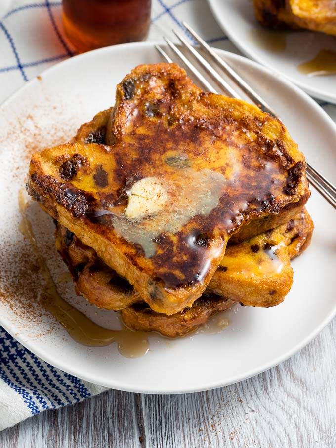 Raisin Bread French Toast Recipe - plated with cinnamon and maple syrup | The Worktop