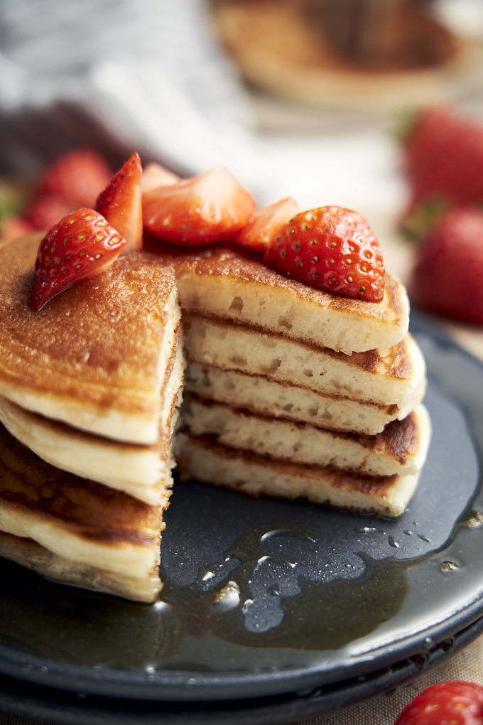 Eggless Pancake Recipe - Cut stack with strawberries | The Worktop
