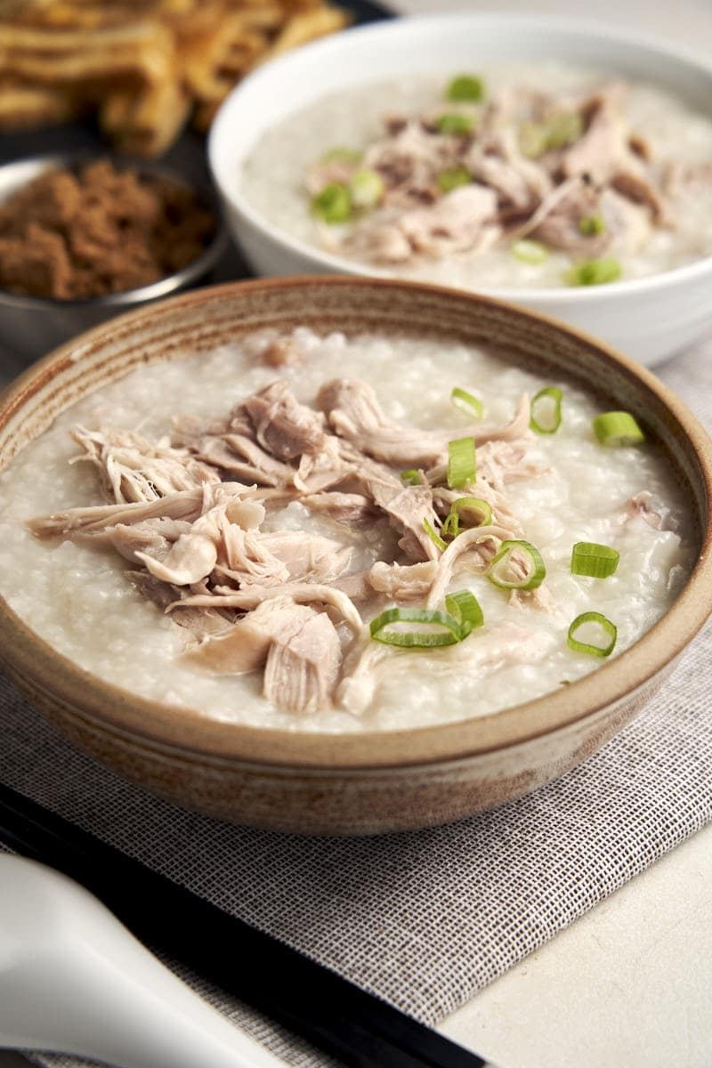 Chicken Congee Slow Cooker - 2 bowls of congee with shredded chicken | The Worktop