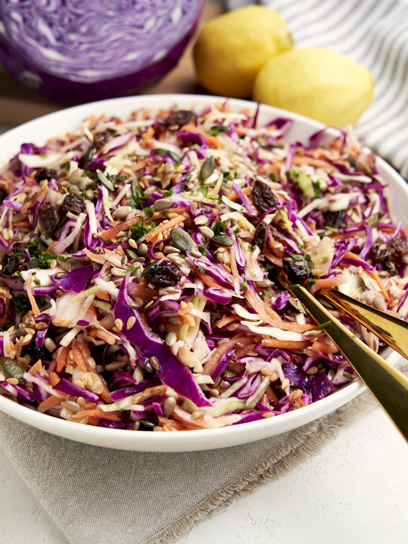 Healthy Coleslaw Recipe - made with no mayo - with golden serving spoon | The Worktop