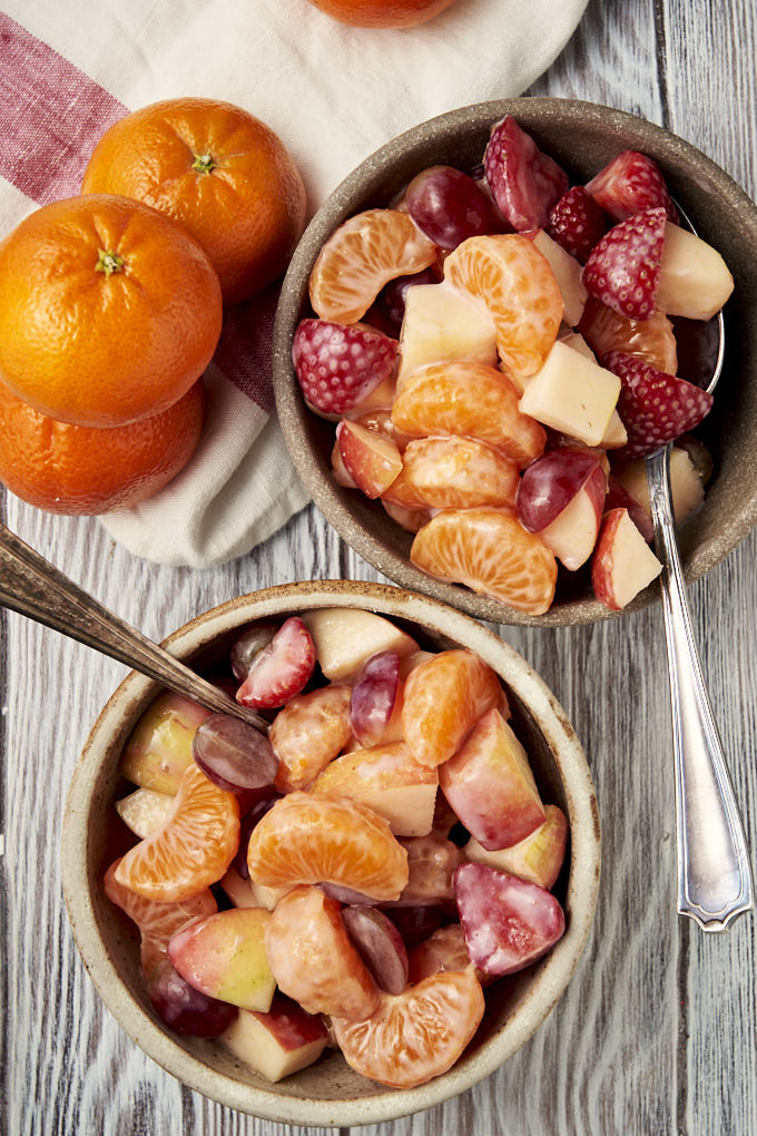 Healthy Fruit Salad Recipe for Kids - oranges, apples, strawberries, grapes and yogurt dressing served in two bowls | The Worktop