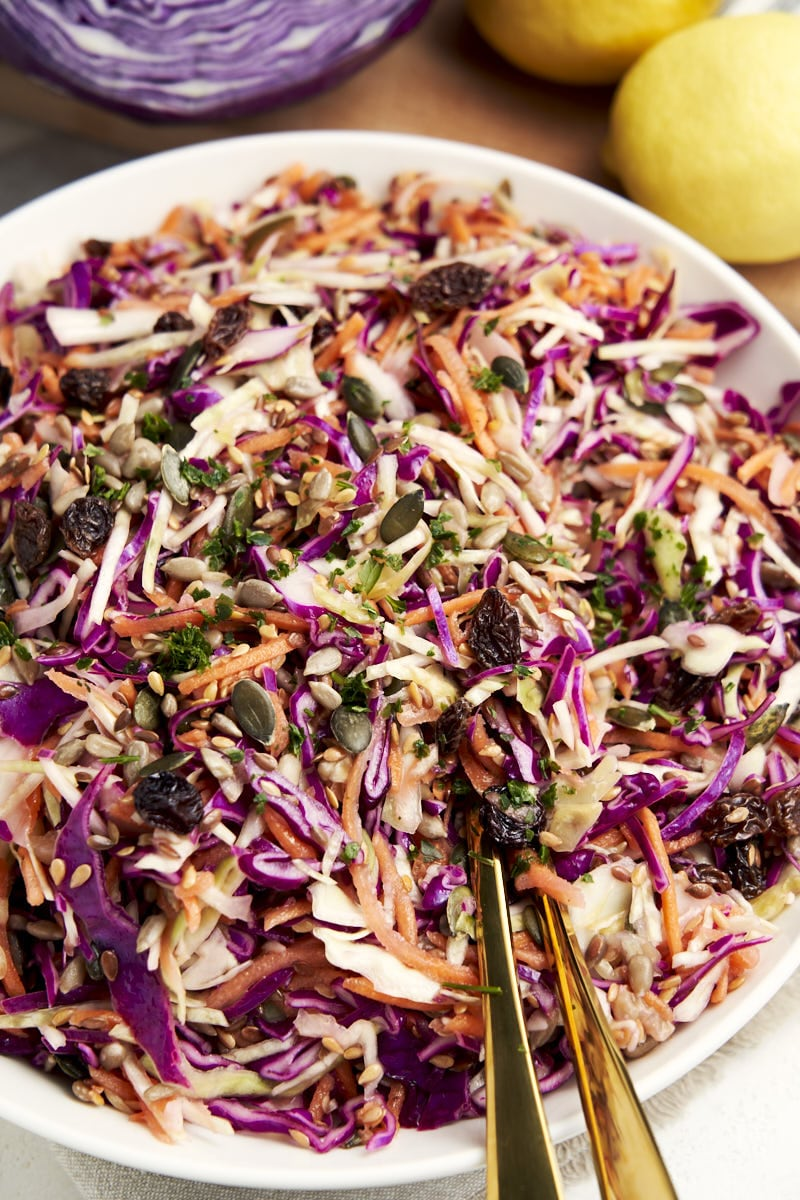 Purple Cabbage Slaw with No Mayo - with olive oil and lemon dressing on a serving plate | The Worktop