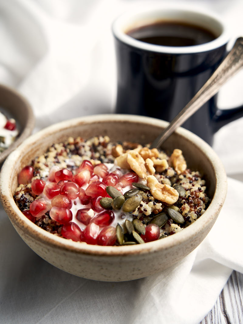 Quinoa Porridge Oatmeal Breakfast - served in bowl with healthy toppings | The Worktop