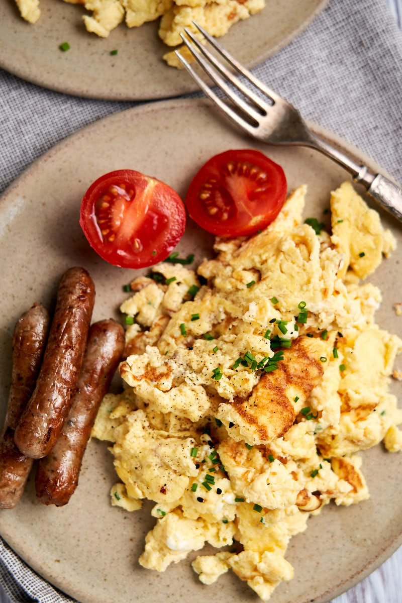 Scrambled Eggs with Cottage Cheese - photo showing it with sausages for breakfast | The Worktop