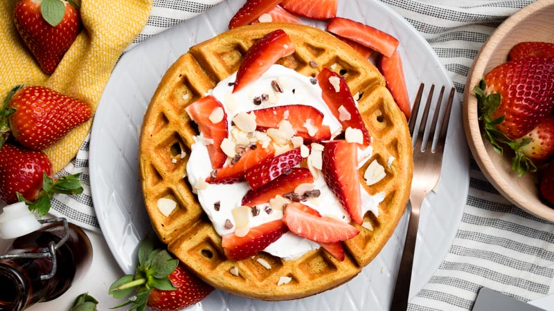 Healthy Waffles - overhead shot topped with Greek yogurt, strawberries and almonds | The Worktop
